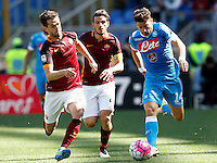 Calcio, Serie A: Roma vs Napoli. Roma, stadio Olimpico, 25 aprile 2016.<br /> Napoli&rsquo;s Dries Mertens, right, is challenged by Roma&rsquo;s Miralem Pjanic, left, and Alessandro Florenzi during the Italian Serie A football match between Roma and Napoli at Rome's Olympic stadium, 25 April 2016.<br /> UPDATE IMAGES PRESS/Riccardo De Luca