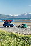 USA, Alaska, Homer, travelers set up camp at the end of the Homer Spit, Land's End, with the Kenai Mountains in the background, Kachemak Bay