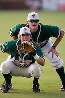 Joe Staples #31 of the Greensboro Grasshoppers plays catcher as Thomas Koehler #52  umpires during warmups at Fieldcrest Cannon Stadium June 13, 2009 in Kannapolis, North Carolina. (Photo by Brian Westerholt / Four Seam Images)