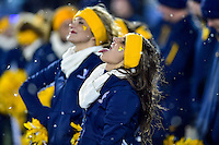 Morgantown, WV - NOV 19, 2016: A West Virginia Mountaineers cheerleader tries to catch a snow flake on their tongue as the snow falls during game between West Virginia and Oklahoma at Mountaineer Field at Milan Puskar Stadium Morgantown, West Virginia. (Photo by Phil Peters/Media Images International)