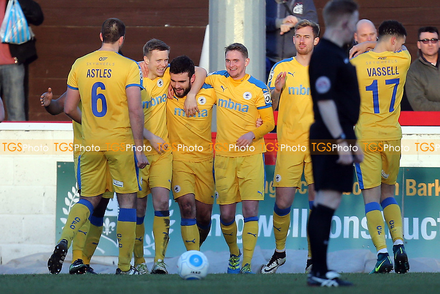 Luke George of Chester is congratulated after scoring the opening Chrster goal during Dagenham & Redbridge vs Chester, Vanarama National League Football at the Chigwell Construction Stadium on 4th February 2017