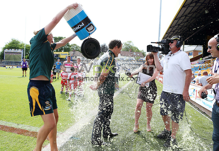 PICTURE BY VAUGHN RIDLEY/SWPIX.COM - Rugby League - Festival of World Cups, Women's Final - Australia Women v New Zealand Women - Headingley, Leeds, England - 14/07/13 - Australia's Head Coach is doused with Powerade.