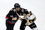 04 January 2015: Carolina's Brad Malone (24) and Boston's Gregory Campbell (11) fight in the first period. The Carolina Hurricanes played the Bruins at the PNC Arena in Raleigh, North Carolina in a 2014-15 National Hockey League game. Carolina won the game 2-1 after a 1-0 shootout victory after overtime.