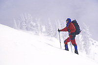 Man climbing in snow, Washington Cascade Mountains
