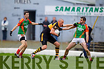 Kieran Donaghy Austin Stacks in action against Ger Hartnett and Fergal Griffin Mid Kerry in the Kerry Senior County Football Final at Fitzgerald Stadium on Sunday.