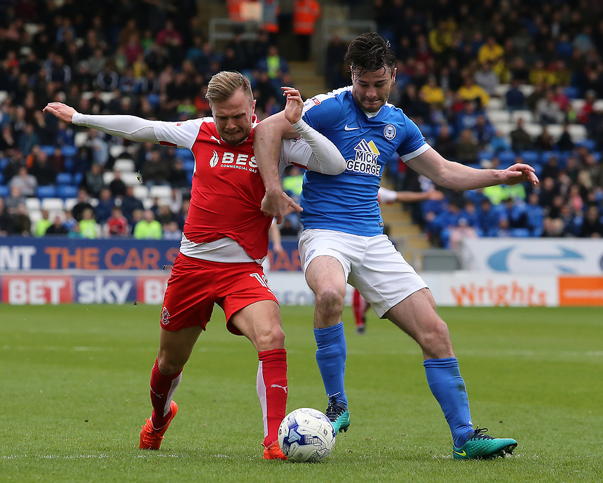 Fleetwood Town's David Ball battles with Peterborough United's Andrew Hughes<br /> <br /> Photographer David Shipman/CameraSport<br /> <br /> The EFL Sky Bet League One - Peterborough United v Fleetwood Town - Friday 14th April 2016 - ABAX Stadium  - Peterborough<br /> <br /> World Copyright &copy; 2017 CameraSport. All rights reserved. 43 Linden Ave. Countesthorpe. Leicester. England. LE8 5PG - Tel: +44 (0) 116 277 4147 - admin@camerasport.com - www.camerasport.com