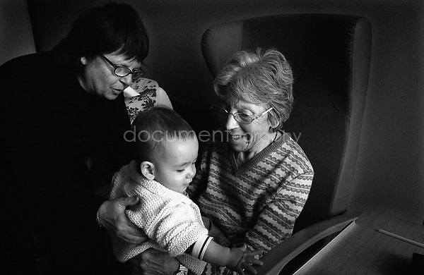 """It is the first time that the """"little monster"""" comes to visit my grandmother. He is my sister's first son and so my grandmother's grand children. When we come and visit her with him we never know if she will recognise all of us...© Magali Corouge/Documentography.2004-2006.France"""