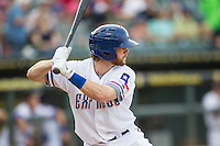 Round Rock Express shortstop Jason Donald (5) at bat during the Pacific Coast League baseball game against the Fresno Grizzlies on June 22, 2014 at the Dell Diamond in Round Rock, Texas. The Express defeated the Grizzlies 2-1. (Andrew Woolley/Four Seam Images)