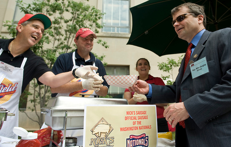Rep. Mike Quigley, D-Ill., chooses the Phillies hot dog over the Nationals sausage at the Hatfield Meats stand during the American Meat Institute's Annual Hot Dog Day lunch in the Rayburn Courtyard on Wednesday, July 22, 2009. The Congressman asked for a Chicago Cubs hot dog, which was not on th menu. From left are John Reininger and Eric Haman of Hatfield Quality Meats.