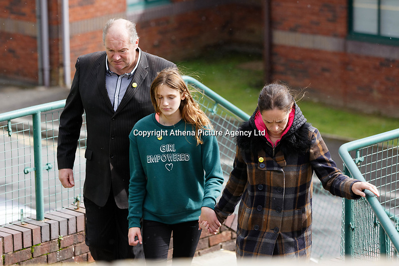 """Pictured L-R: Byron John, daughter Danielle and partner Kate Pickard  after delivering the letter to St John Lloyd School in Llanelli, Wales, UK. Friday 21 September 2018<br /> Re: The grieving father of a bullied pupil who hanged himself in school toilets is calling for the headteacher's resignation.<br /> Heartbroken Byron John claims his son Bradley, 14, would still be alive if the school had acted to stop the bullies.<br /> Mr John, 53, will hand in a formal letter of complaint to the school today (Fri) demanding head Ashley Thomas resigns.<br /> Bradley's 12-year-old sister Danielle found him dead in the toilet block at St John Lloyd Roman Catholic School in Llanelli, South Wales.<br /> Mr John claims his son had been missing for an hour before teachers refused to break down the door of the cubicle where the troubled teenager was found.<br /> Farmer Mr John said: """"I'm very unhappy at the way the school has handled things both before Bradley died, on the day it happened and since.<br /> """"There was a systematic failure of any workable anti-bullying policy.<br /> """"There was a failure to follow up our concerns and those of the healthcare professionals helping my son."""""""