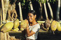 INDIA Little Andaman, Nicobarese woman carry coconuts on bamboo yoke / INDIEN Little Andaman, Nikobaresen Frau traegt Kokosnuesse