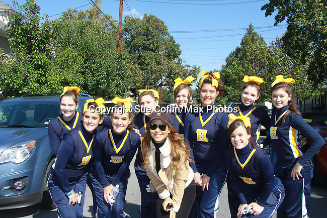 "Hedgesville High School Cheerleaders pose with General Hospital Lisa LoCicero ""Olivia Falconeri"", Loving ""Joscelyn Roberts Brown"" moving onto The City and One Life To Live ""Sonia Toledo Santi"" is the Celebrity Grand Marshal aboard a Mitsubishi Eclipse in the 2011 Grand Feature Parade at the 32nd Annual Mountain State Apple Harvest Festival on October 15, 2011 in Martinsburg, West Virginia. (Photo by Sue Coflin/Max Photos)"