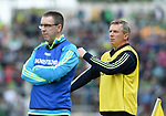 A tense looking Donal Moloney, Clare joint manager, behind Gerry O Connor, fellow Clare joint manager, during their Munster Championship semi-final against Limerick at Thurles.  Photograph by John Kelly.
