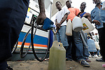 With water, gas, and just about everything else in short supply, survivors of the January 12 earthquake line up for gas in a Port-au-Prince, Haiti, gasoline station.