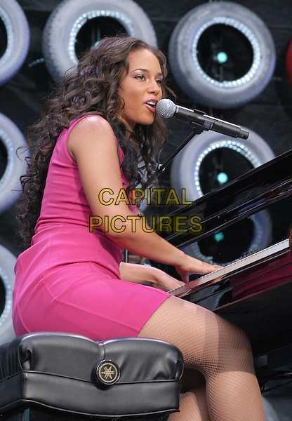 ALICIA KEYS.At the Live Earth New York Show held at Giants Stadium, East Rutherford, New Jersey, USA,.07 July 2007..concert on stage gig half length pink dress sitting at piano.CAP/ADM/MK.©Mike Klein/AdMedia/Capital Pictures.