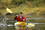 Mature man kayaking on river