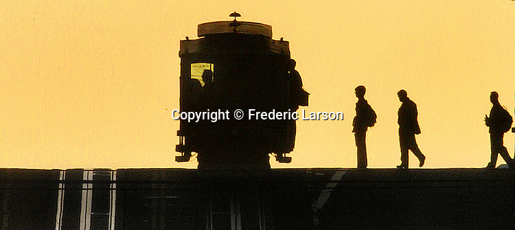 The California cable car stops on top of Nob Hill to pick up early morning commuters in San Francisco, California..