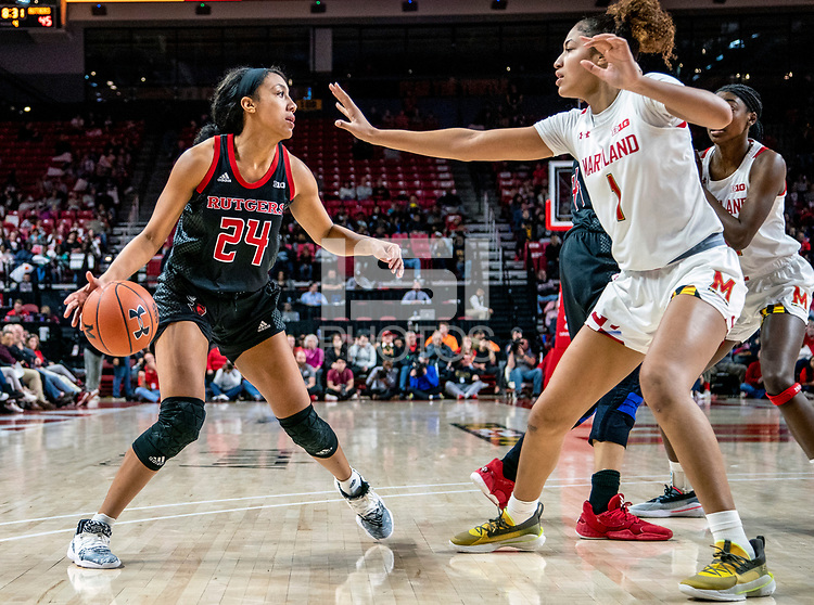 COLLEGE PARK, MD - FEBRUARY 9: Shakira Austin #1 of Maryland defends against Arella Guirantes #24 of Rutgers during a game between Rutgers and Maryland at Xfinity Center on February 9, 2020 in College Park, Maryland.
