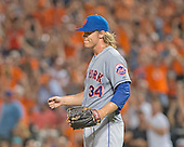 New York Mets starting pitcher Noah Syndergaard (34) after giving up a two run home run to Baltimore Orioles second baseman Jonathan Schoop (6) in the sixth inning against the Baltimore Orioles at Oriole Park at Camden Yards in Baltimore, Maryland on Wednesday, August 19, 2015.  The Orioles won the game 5 - 4.<br /> Credit: Ron Sachs / CNP<br /> (RESTRICTION: NO New York or New Jersey Newspapers or newspapers within a 75 mile radius of New York City)