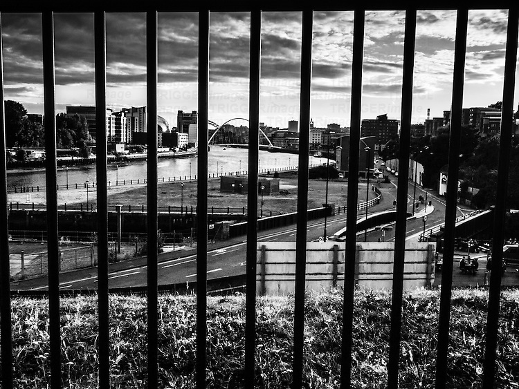 The river Tyne viewed through railings