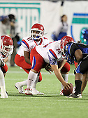 Manatee Hurricanes quarterback Brodrick Yancy #11 under center Austin Reeves #74 during the fourth quarter of the Florida High School Athletic Association 7A Championship Game at Florida's Citrus Bowl on December 16, 2011 in Orlando, Florida.  Manatee defeated First Coast 40-0.  (Photo By Mike Janes Photography)