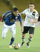 BOGOTA - COLOMBIA -15 -04-2015: Kevin Rendon (Izq) jugador de Millonarios disputa el balón con Henry Rojas (Der) jugador de Alianza Petrolera durante partido por la fecha 15 de la Liga Águila I 2015 jugado en el estadio Nemesio Camacho El Campín de la ciudad de Bogotá./ Kevin Rendon (L) player of Millonarios fights for the ball with Henry Rojas (R) player of Alianza Petrolera during the match for the 15th date of the Aguila League I 2015 played at Nemesio Camacho El Campin stadium in Bogotá city. Photo: VizzorImage / Gabriel Aponte / Staff.