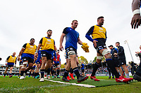 Bath Rugby players make their way off the field at the end of the pre-match warm-up. Heineken Champions Cup match, between Bath Rugby and Stade Toulousain on October 13, 2018 at the Recreation Ground in Bath, England. Photo by: Patrick Khachfe / Onside Images