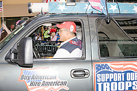 "A man drives a truck adorned with patriotic symbols including signs reading ""Buy American / Hire American"" and ""Support Our Troops"" in the Straight Pride Parade in Boston, Massachusetts, on Sat., August 31, 2019."