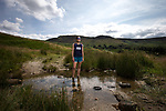 © Joel Goodman - 07973 332324 . 21/07/2014 . Oldham , UK . Gaynor on the moors above Dovestone Reservoir . Runner GAYNOR KEANE recently completed the Bob Graham Challenge in under 24 hours . Photo credit : Joel Goodman