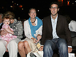 28 August 2006: 2006 inductee Alexi Lalas's (not pictured) daughter Sophie (l), held by his mother Anne Woodworth, wife Ann Lalas (center), and his brother Greg Lalas (r). The National Soccer Hall of Fame Induction Ceremony was held at the National Soccer Hall of Fame in Oneonta, New York.