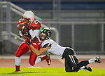 Lawndale, CA 09/26/14 - Bryant Perkinson (Lawndale #21) and Jason Burr (Peninsula #7) in action during the Palos Verdes Peninsula vs Lawndale CIF Varsity football game at Lawndale High School.  Lawndale defeated Peninsula 42-21