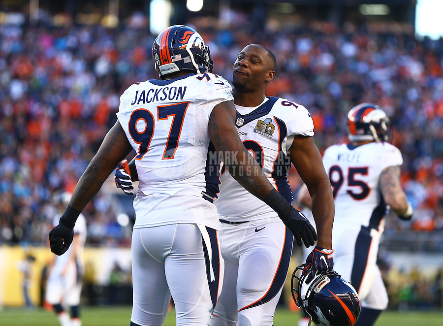 Feb 7, 2016; Santa Clara, CA, USA; Denver Broncos defensive tackle Malik Jackson (97) celebrates a first quarter defensive touchdown with defensive end Antonio Smith (90) against the Carolina Panthers in Super Bowl 50 at Levi's Stadium. Mandatory Credit: Mark J. Rebilas-USA TODAY Sports