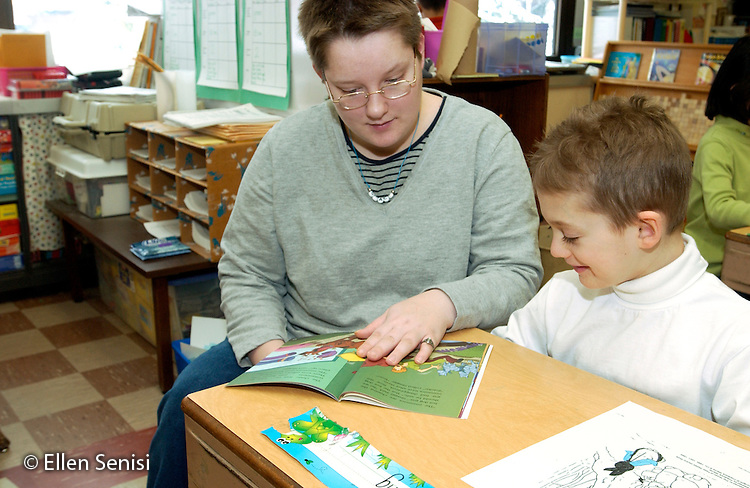 MR / Olean, NY /.Washington West Elementary School, First Grade.Boy (6) reads aloud to visiting adult reading partner from group home. Unique program called Friday Friends pairs adult consumers with special needs with school children. As part of a business-school partnership, consumers and students participate together in reading, crafts, and free time activities. The program's objective is to bring people with and without disabilities together regularly. It is supported by a local, annual fund raising event and hours contributed by volunteers..MR: Lon2   Bur7.© Ellen B. Senisi
