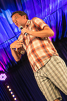 20th July 2014: German comedian and panel show regular Henning Wehn plays the Comedy Arena on the fourth day of the 9th edition of the Latitude Festival, Henham Park, Suffolk.<br /> Picture by Stuart Hogben