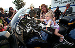 Lori Geiger watches her granddaughter Tatum Geiger, 1, check out a Nevada Highway Patrol motorcycle during the 11th annual National Night Out hosted by the Carson City Sheriff's Office in Carson City, Nev., on Tuesday, Aug. 6, 2013. <br />