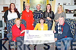 Nora Piggott, Killarney, pictured as she presented a cheque for ?1,100 to Henry Burrows,Tralee/West Kerry MS after she was part of a group of 12  who took part in the Flora Womens marathon.Also pictured are Anne Burrows, Emily Piggott, Mary O'Connor, John Foley, Mary O'Callaghan and Linda Piggott. .