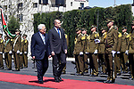 Palestinian President Mahmoud Abbas reviews an honour guard with his guest, Bulgarian President Rumen Radev, in the West Bank city of Ramallah on March 22, 2018. Photo by Thaer Ganaim