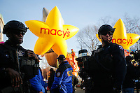 Members of the New York Police Department's Emergency Service Unit stand guard before the 89th Macy's Thanksgiving Annual Day Parade in the Manhattan borough of New York.  11/26/2015. Eduardo MunozAlvarez/VIEWpress