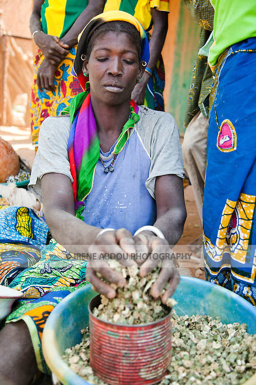 In the town of Djibo in northern Burkina Faso, women sell dried okra in the market.