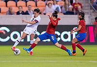 HOUSTON, TX - FEBRUARY 03: Carli Lloyd #10 of the United States cuts back away from Jazmin Elizondo #19 of Costa Rica during a game between Costa Rica and USWNT at BBVA Stadium on February 03, 2020 in Houston, Texas.