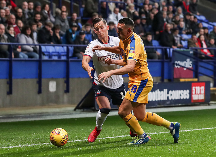 Bolton Wanderers' Pawel Olkowski competing with Wigan Athletic's Gary Roberts <br /> <br /> Photographer Andrew Kearns/CameraSport<br /> <br /> The EFL Sky Bet Championship - Bolton Wanderers v Wigan Athletic - Saturday 1st December 2018 - University of Bolton Stadium - Bolton<br /> <br /> World Copyright © 2018 CameraSport. All rights reserved. 43 Linden Ave. Countesthorpe. Leicester. England. LE8 5PG - Tel: +44 (0) 116 277 4147 - admin@camerasport.com - www.camerasport.com