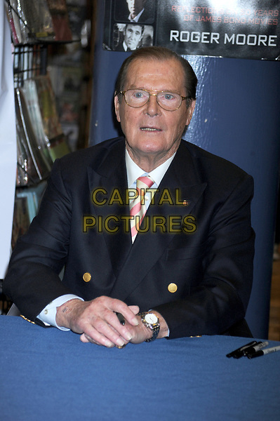 Actor Sir Roger Moore, best known for playing James Bond, has died aged 89, his family has announced after &quot;a short but brave battle with cancer&quot;.<br /> STOCK PHOTO: Roger Moore promotes his new book Bond On Bond at Barnes and Noble in New York City. November 09, 2012.. <br /> CAP/MPI/DVT<br /> &copy;DVT/MPI/Capital Pictures