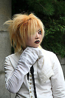 """A wide variety of """"costume play"""" getups are shown here: goths, cartoon characters from Japanese manga, anime,  the sweet-and-innocent frilly look or combinations in between (goth lolly)  Every Sunday, these cosplay characters converge on Harajuku, Tokyo's fashion quarter. Most casual observers say that cosplay is a reaction to the rigid rules of Japanese society. But since so many cosplay girls congregate in Harajuku and Aoyama - Tokyo headquarters of Fendi, Hanae Mori and Issey Miyake, others consider it is a reaction to high fashion. Whatever the cause, cosplay aficionados put a tremendous amount of effort into their costumes every Sunday. One wonders what they wear on Monday morning..."""