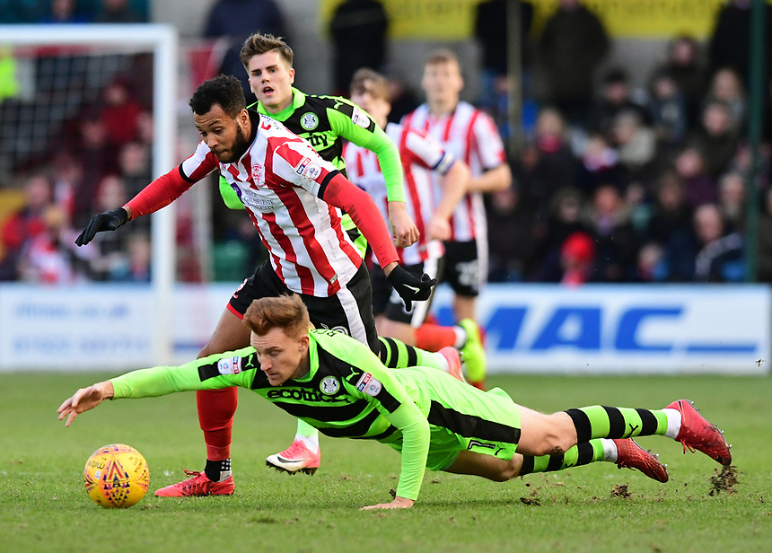 Lincoln City's Matt Green vies for possession with Forest Green Rovers' Mark Roberts<br /> <br /> Photographer Chris Vaughan/CameraSport<br /> <br /> The EFL Sky Bet League Two - Lincoln City v Forest Green Rovers - Saturday 30th December 2017 - Sincil Bank - Lincoln<br /> <br /> World Copyright &copy; 2017 CameraSport. All rights reserved. 43 Linden Ave. Countesthorpe. Leicester. England. LE8 5PG - Tel: +44 (0) 116 277 4147 - admin@camerasport.com - www.camerasport.com