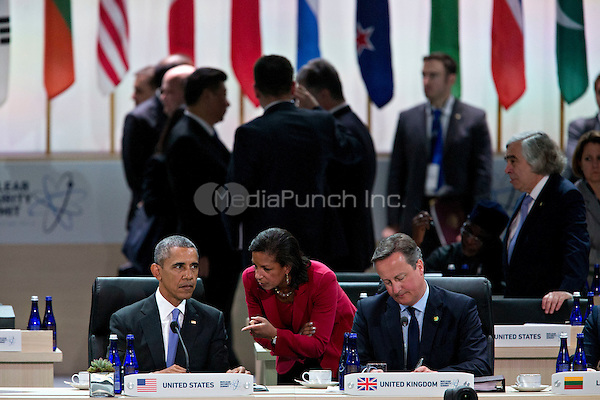 United States President Barack Obama, left, talks to Susan Rice, U.S. national security advisor, center, during a closing session with David Cameron, U.K. prime minister, right, at the Nuclear Security Summit in Washington, D.C., U.S., on Friday, April 1, 2016. After a spate of terrorist attacks from Europe to Africa, Obama is rallying international support during the summit for an effort to keep Islamic State and similar groups from obtaining nuclear material and other weapons of mass destruction. <br /> Credit: Andrew Harrer / Pool via CNP/MediaPunch