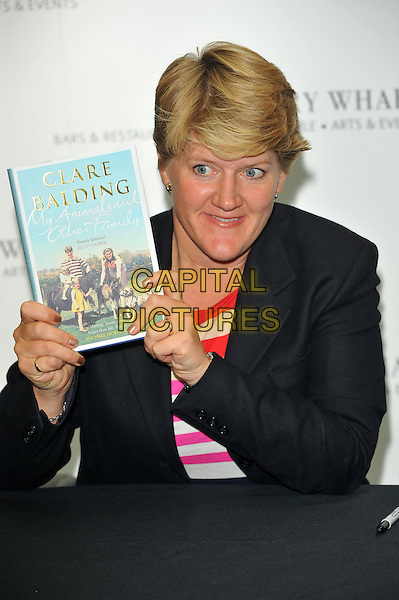 Clare Balding.Book signing of 'My Animals and Other Family' at Waterstones, Canary Wharf, London, England..September 18th, 2012.half length table red white stripe top blazer.CAP/CJ.©Chris Joseph/Capital Pictures.