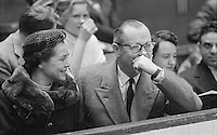 American film and television actor Robert Montgomery (1904-1981) watches tennis match between Pancho Gonzales and Ken Rosewall, Madison Square Garden, 1957.<br /> Photograph by John G. Zimmerman.