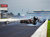 May 21, 2018; Topeka, KS, USA; NHRA top alcohol dragster driver Steve Collier flips over after suffering a blowover crash during the Heartland Nationals at Heartland Motorsports Park. Collier was talking with safety personnel before being transported to a local hospital for an evaluation. Mandatory Credit: Mark J. Rebilas-USA TODAY Sports