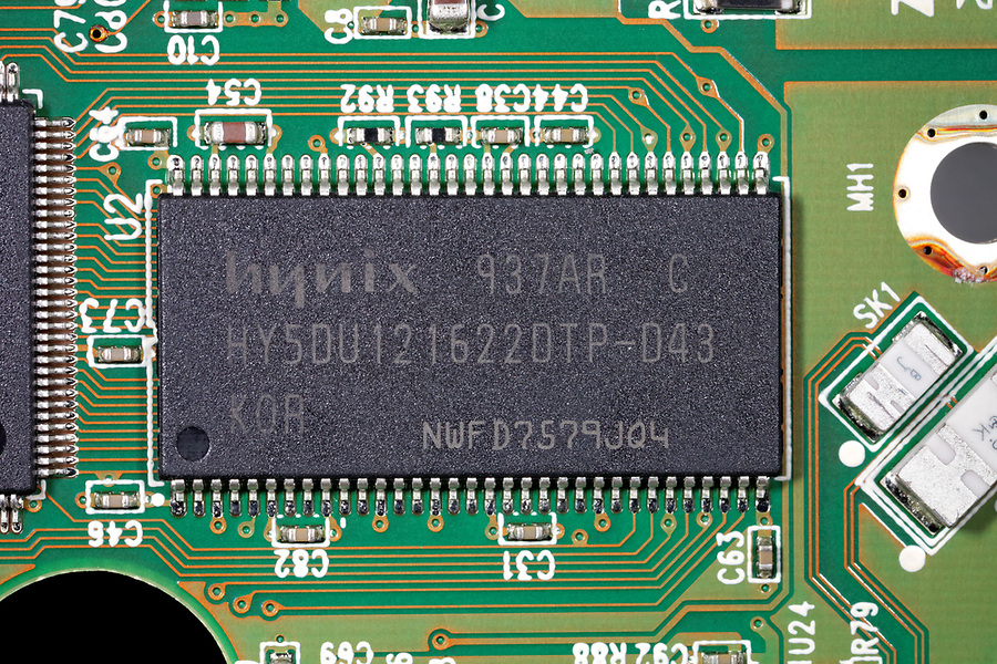 Close-up of Hynix hy5du121622dtp synchronous DRAM integrated circuit on hard disk drive printed circuit board