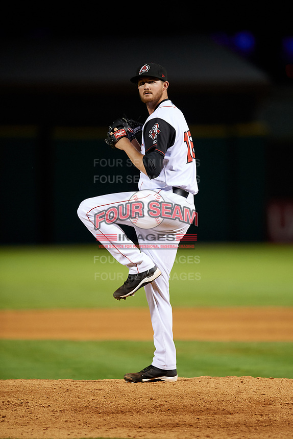 Arkansas Travelers relief pitcher Blake Perry (18) gets ready to deliver a pitch during a game against the Midland RockHounds on May 25, 2017 at Dickey-Stephens Park in Little Rock, Arkansas.  Midland defeated Arkansas 8-1.  (Mike Janes/Four Seam Images)
